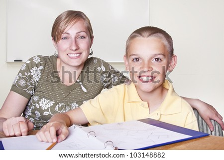 Elementary School Teacher and her student - stock photo
