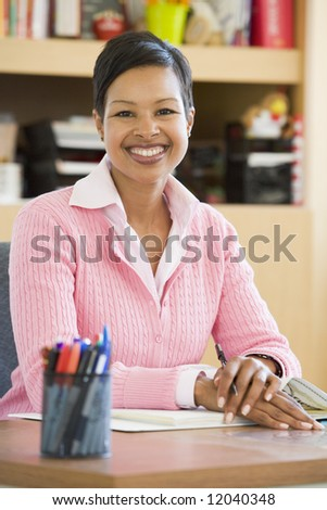 Elementary school teacher in office - stock photo