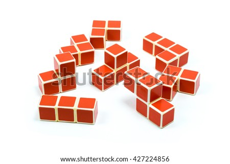 Elements of old soviet red plastic cube puzzle on white background - stock photo