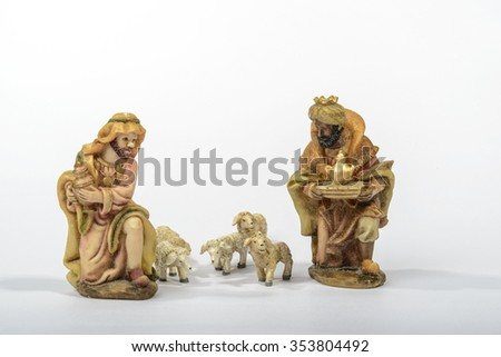 Elements of the Catholic Christian crib on the white background / The Two Wise Men and sheep - stock photo