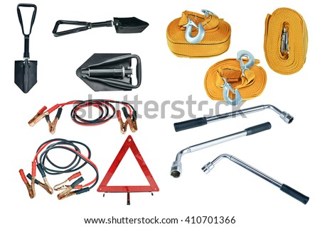 Elements of the essentials for a passenger car. Danger Safety Warning Triangle Sign, towing rope, fire extinguisher, Jumper cable, wheel wrench and shovel. - stock photo