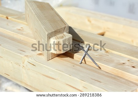 Elements of timber construction with screws  - stock photo
