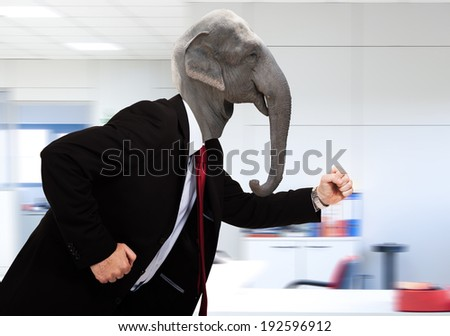 Elephant business man running in the office - stock photo