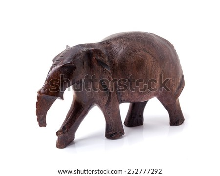 Elephant carved out of wood. African handmade souvenirs - stock photo
