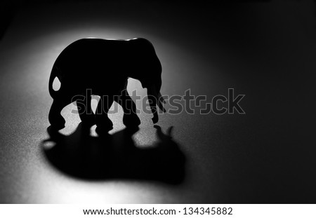 Elephant figure on a dark background