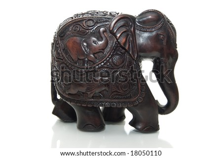 Elephant is made of red wood isolated on white background - stock photo