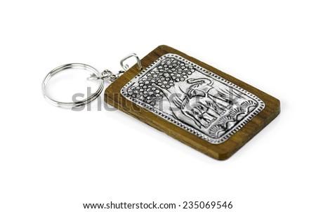Elephant keychain on wood isolated on white background - stock photo
