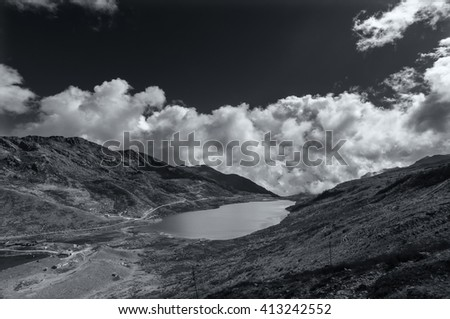 Elephant Lake, named due to it's shape as a lying elephant, remote high altitude lake at kupup Valley, Sikkim. Himalayan mountain range, Sikkim, India - black and white image