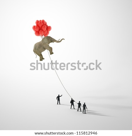 Elephant lifted by balloons and held on a rope by tiny people
