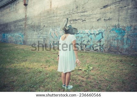 elephant mask halloween young beautiful moroccan curly woman at the park - stock photo