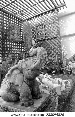 elephant statue on the garden - stock photo