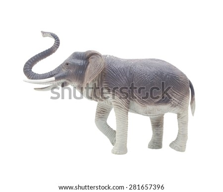 Elephant toy profile. Isolated blue and grey elephant toy standing on white background profile view.