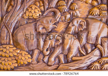 Elephant wood carving from Thailand. - stock photo