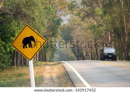elephants crossing sign in Thailand - Erawan national park - Kanchanaburi province - stock photo