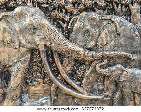 Elephants stone sculpture on the wall in Thailand public temple - stock photo