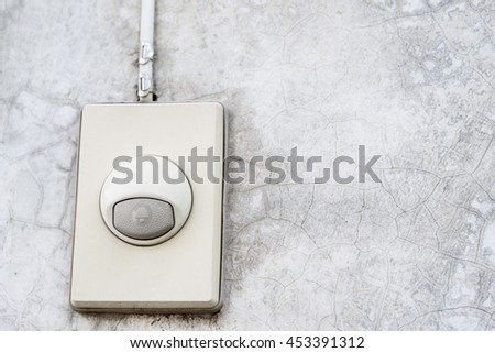 Eletronic old doorbell set up in house concrete wall close up.