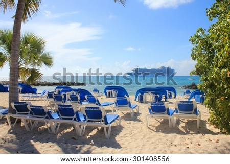 ELEUTHERA, BAHAMAS - FEBRUARY 9, 2014 : View from Princess Cays beach on Crown Princess ship anchored at sea. Princess Cays is a private resort of Princess Cruises - stock photo