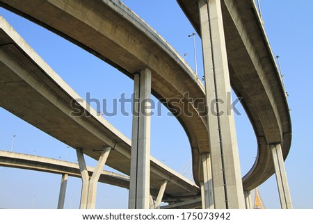 Elevated express way against blue sky background  - stock photo