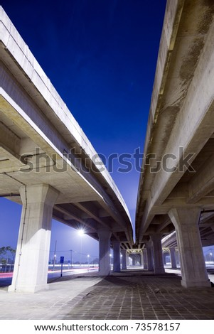 elevated express way at night time - stock photo