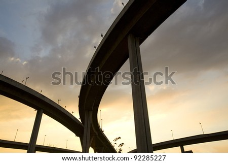 elevated express way at sunset - stock photo