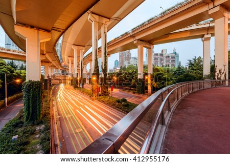 Elevated Highway at night with light trails in Shanghai, China.  - stock photo