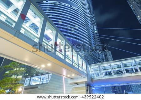 elevated pedestrian walkway at night - stock photo