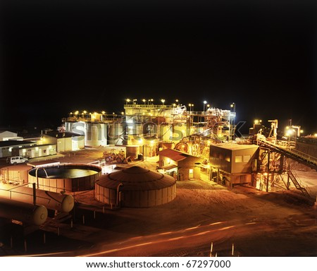 Elevated view of Gold Mine processing plant at night - stock photo