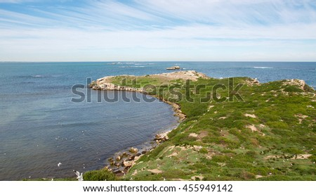 Elevated view of Indian Ocean cove and lush dunes at Penguin Island in Rockingham, Western Australia/Cove and Lush Dunes/Penguin Island, Rockingham, Western Australia - stock photo
