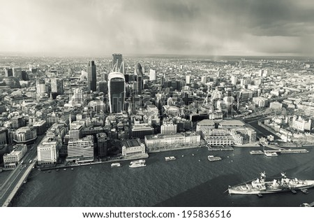Elevated view of The City of London on a rainy spring afternoon. Retro toned. - stock photo