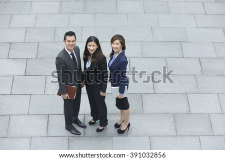 Elevated view of three Chinese Business colleagues. Group of 3 Asian business men and women.  - stock photo