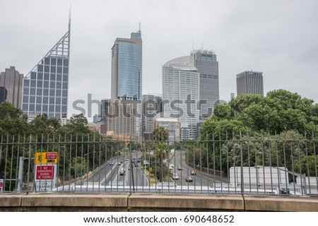 Elevated view over roadway traffic and cityscape in Sydney, Australia/Traffic in Sydney/SYDNEY,NSW,AUSTRALIA-NOVEMBER 19,2016:Elevated view over traffic on roadway with cityscape in Sydney, Australia