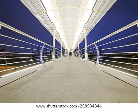 Elevated walkway in the night - stock photo