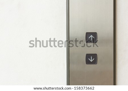 elevator black button up and down direction on wall - stock photo