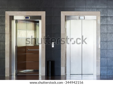 Elevator cabin stainless steel in a room on floor