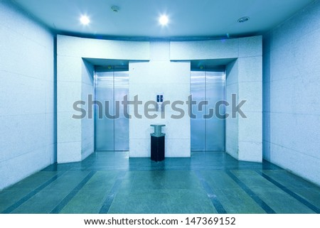 elevator in building lobby - stock photo