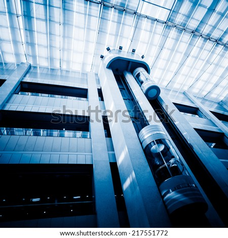 elevator in hotel, blue toned iamges. - stock photo