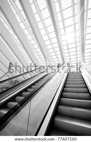 Elevator in the modern futuristic interior with concrete arches on background - stock photo
