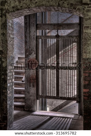Elevator or Lift With Bell in the Abandoned Lonaconing Silk Mill in Lonaconing, Maryland - stock photo