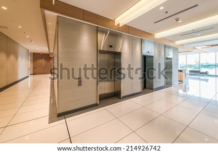 Elevators in the modern lobby, hallway of the luxury hotel, business center, shopping mall in Vancouver, Canada. Interior design. - stock photo