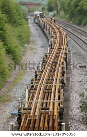 ELFORD, UK - MAY 8: A class 66 diesel locomotive operated by DBS hauls a freight train of new railway track to the engineering depot in preparation for installation on May 8, 2015 in Elford