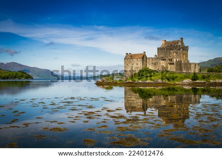 Elian Donan Castle sitting over water with reflection  - stock photo