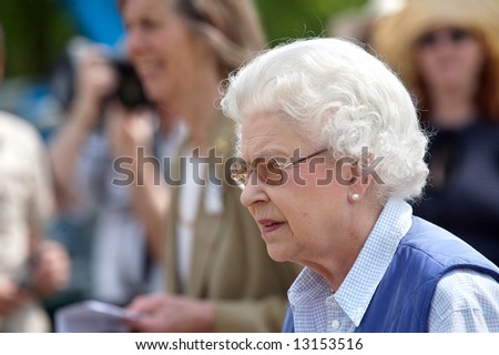 Elizabeth II with people - stock photo