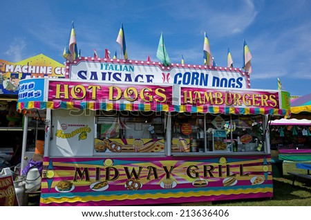 ELIZABETHTOWN, PA, USA-AUGUST 18, 2014:  Carnivals and country fairs are in full swing. They are common in late summer and early fall and include exhibits, food, rides, and entertainment for all ages. - stock photo