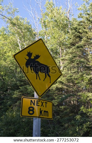 Elk crossing sign, Riding Mountain National Park, Manitoba, Canada - stock photo