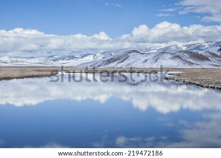 Elk Refuge Reflections taken in winter season in Jackson Hole Wyoming. - stock photo