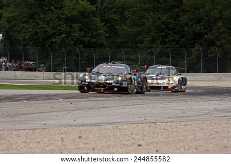 Elkhart Lake Wisconsin, USA - August 18, 2012: Road America Road Race Showcase, ALMS / IMSA sports car GT race. American Le Mans Series Four-hour, timed. Bill Sweedler, Townsend Bell, Lotus Evora  - stock photo