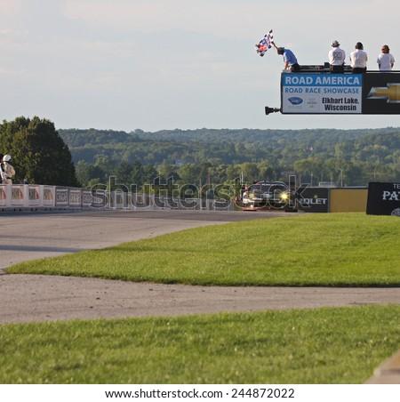 Elkhart Lake Wisconsin, USA - August 18, 2012: Road America Road Race Showcase, ALMS, multi-class sports car GT motor race. American Le Mans Series / IMSA. Bill Sweedler, Townsend Bell, Lotus Evora  - stock photo