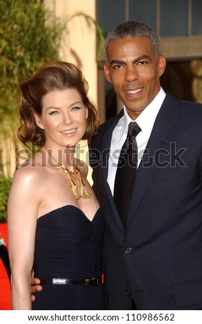 Ellen Pompeo and Christopher Ivey  arriving at the 59th Annual Primetime Emmy Awards. The Shrine Auditorium, Los Angeles, CA. 09-16-07 - stock photo