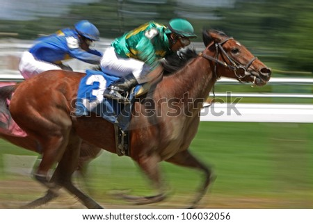 "ELMONT, NY - JUN 23: Rajiv Maragh and ""Special Guest"" (#3) finish in third place in a maiden race at Belmont Park on Jun 23, 2012 in Elmont, NY. - stock photo"
