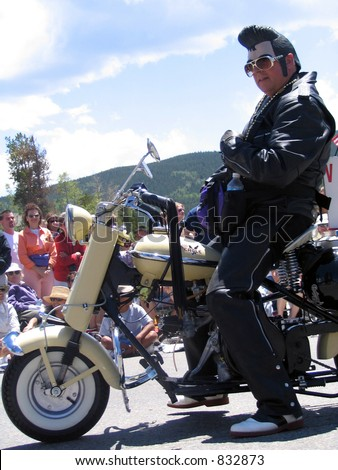 elvis on a bike - stock photo